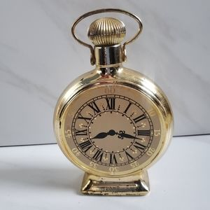 Vintage avon clock decanter after shave